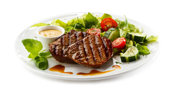 plate of steak and salad